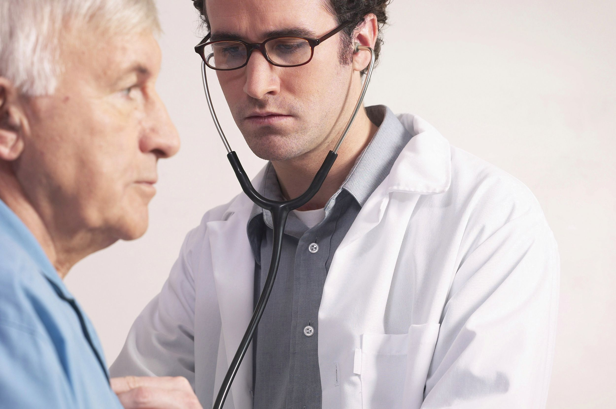 Doctor examining elderly man_12178