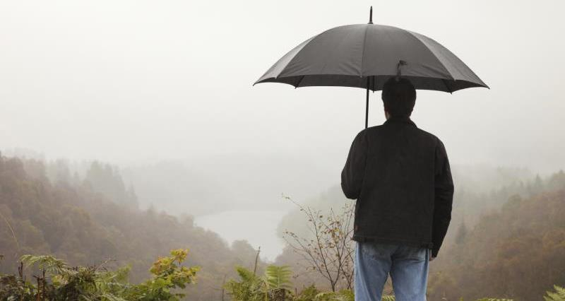 Man with umbrella, Scotland_13174