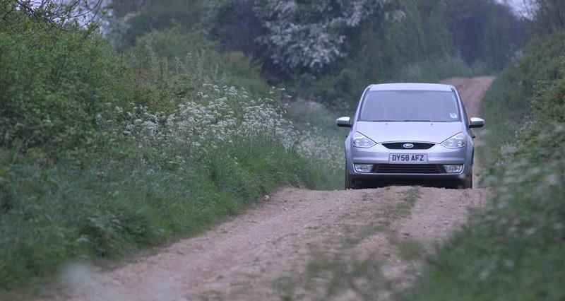Car driving on country lane_64048