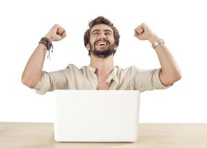 man cheering in front of a laptop_38262