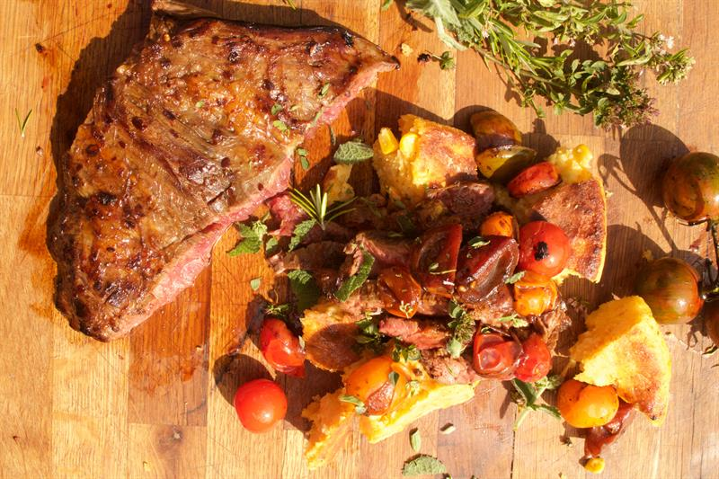 Bavette steak with roasted squash cornbread and tomatoes_69347