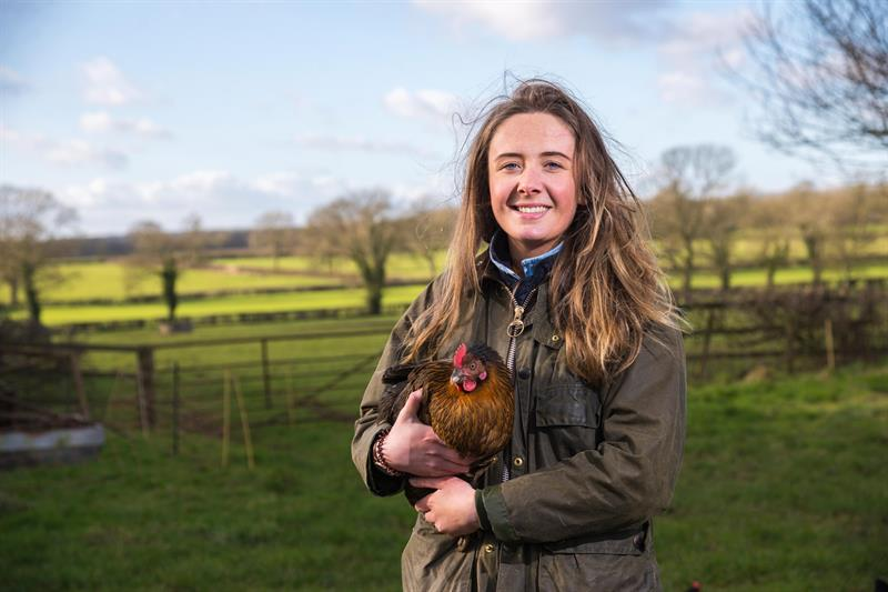 Young farmer Chloe Dunn holding one of her chickens_72723