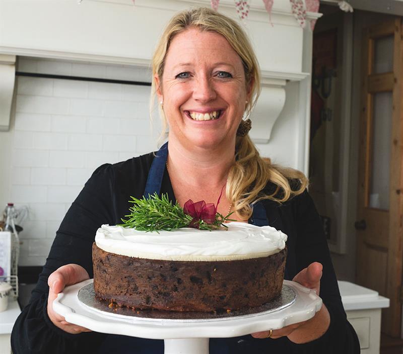 Miranda Gore Browne holding her Christmas cake_69724