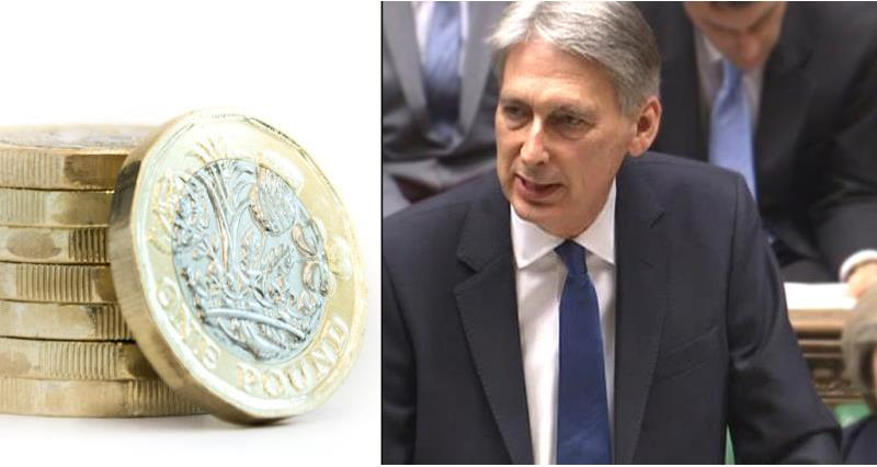chancellor philip hammond and new pound coin - spring statement_52631