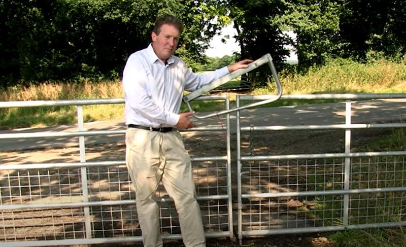 adam quinney, warwickshire farmer, talks abouting badger proofing measures on farm_74234