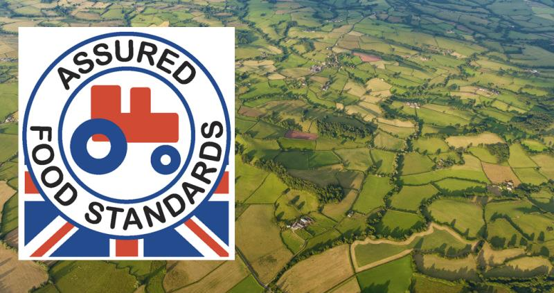 red tractor logo on aerial view of countryside, web crop_39669