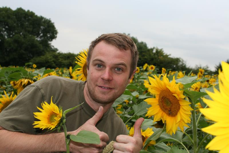 Olly Harrison  with his sunflowers 5_37298
