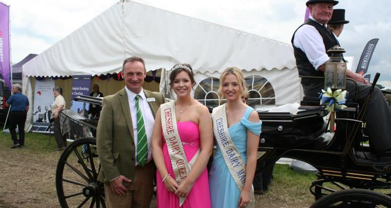 NFU North West Regional Director David Hall with the 2016 Cheshire Dairy Queen Lisa Oakes and Dairy Maid Catherine Bull._35717