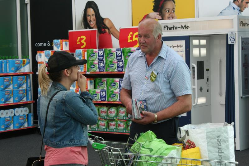 Shoppers in Manchester were pleased to meet a real dairy farmer and had plenty of questions for NFU Cheshire County Chairman Ray Brown_37275