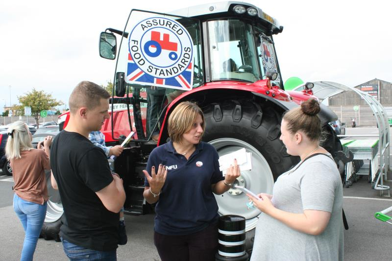 NFU Cheshire County Adviser Helen Wainwright promotes the Red Tractor logo to shoppers in Manchester_37274