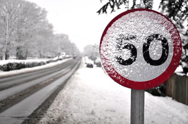 Snowy speed limit sign_19961