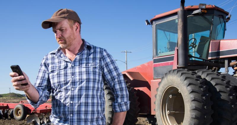 istock farmer texting outdoors in farm field web crop_52747