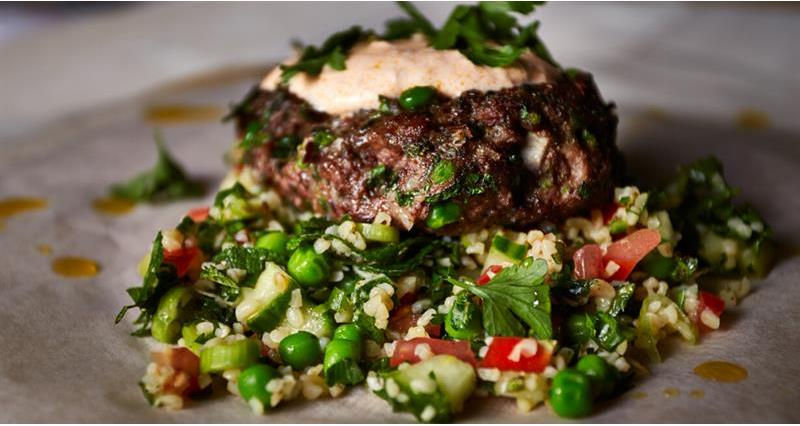 Mint and pea lamb kofta burger with rose yoghurt and pea, mint and cucumber tabbouleh