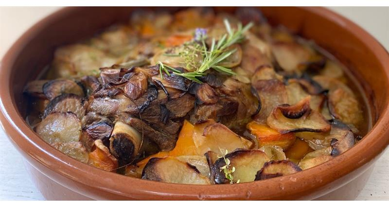 Herbed shoulder of  slow-cooked lamb and veg