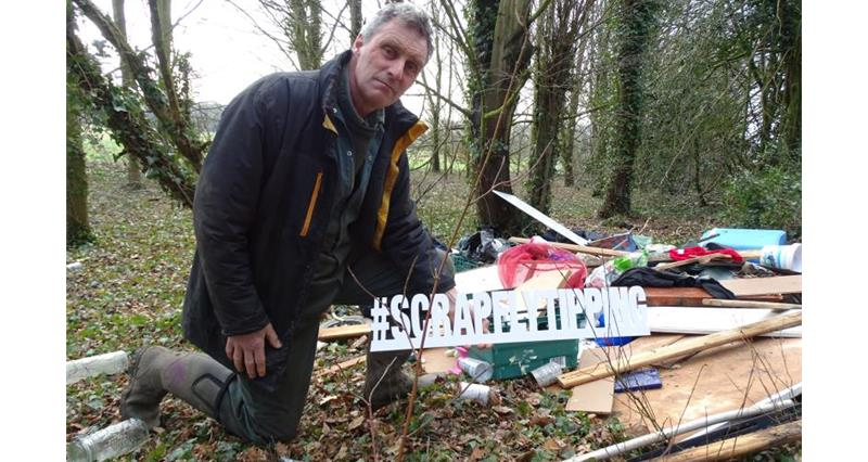 Will Dickinson with fly tipping_52470
